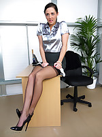 Beautiful secretary Daisy Watts feels the urge to strip from her clothes