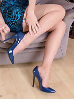 Stunning Sophia flashing her sexy legs and shiny blue stilettos